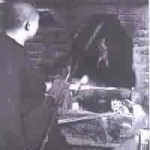 A Peking Duck being roasted by a hung oven circa 1933.