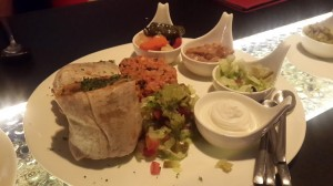 The Burrito, filled to the brim with Mexican rice and grilled peppers, are served with the works – sour cream, more Mexicano rice, black bean gravy and pico de gaio.