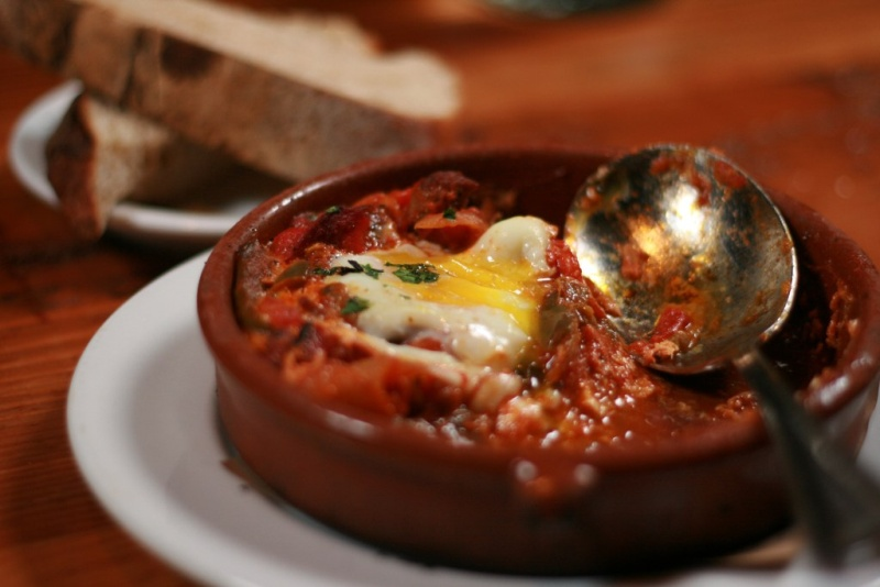 A standard Turkish breakfast, called Menemen, is a spread that has a variety of olives ( Zeytin) and cheese (Peynir), tomatoes, cucumbers, jam and honey with half boiled eggs or scrambled eggs and Turkish sausages.