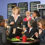 Restaurant owner with a group of unhappy customers