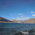 Pangong Lake offers a breathtaking view of a water body flanked by rugged mountains.