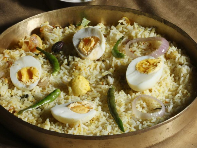 Hyderabad egg biryani is prepared with rice, egg and spices. This can be served with raita.