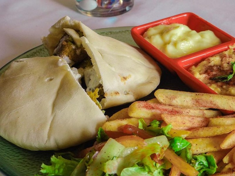 Grilled Chicken Pita Pockets with Sumac French Fries, Lettuce Salad, Garlic Toum and Hummus
