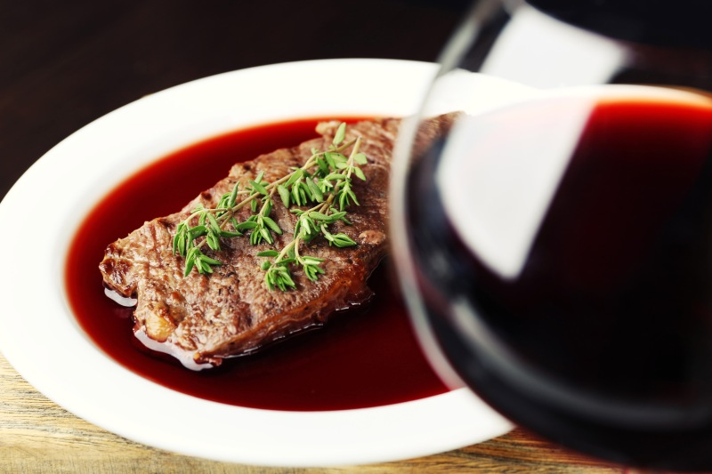 Grilled beef steak with red wine sauce