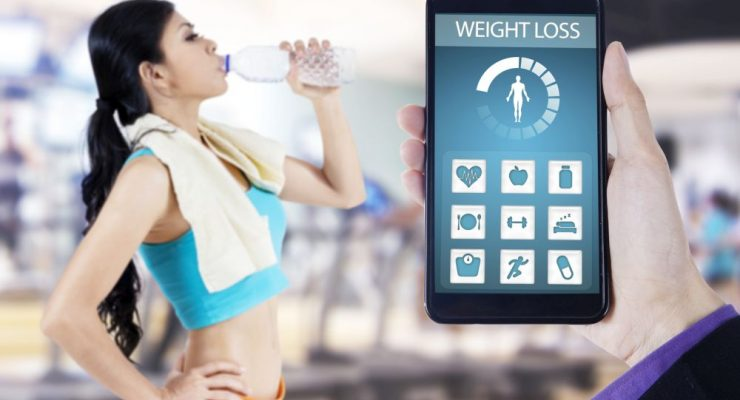 Health app and woman drinking water